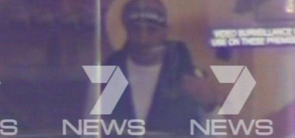epa04530019 A screengrab  from Channel 7 News, Sydney, via Australian Associated Press of a man  believed to be a gunman inside the Lindt Cafe in Martin Place, Sydney 15 December 2014 who is understood to be holding up to 50 people hostage. Witnesses described how the man wearing a headband covered in Arabic lettering walked into the cafe and produced a shotgun. Hostages were seen holding up a black Islamic flag up to the window  EPA/SEVEN NEWS TV CHANNEL  HANDOUT EDITORIAL USE ONLY/NO SALES