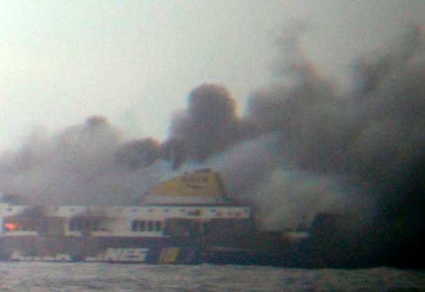 In this photo taken from a nearby ship, smoke rises from the Italian-flagged Norman Atlantic ferry after it caught fire in the Adriatic Sea, Sunday, Dec. 28, 2014. The ferry carrying some hundreds of passengers caught fire off the Greek island of Corfu early Sunday, trapping passengers on the top decks as gale-force winds and choppy seas hampered their evacuation. (AP Photo/SKAI TV Station) GREECE OUT, MANDATORY CREDIT