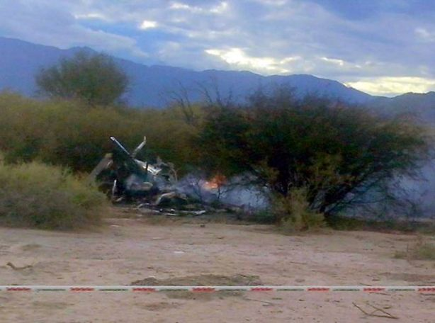 Picture of the burning wreckages of two helicopters which collided mid-air near Villa Castelli, in the Argentine province of La Rioja, on March 9, 2015. Eight French nationals, including sports stars, filming a reality TV show were killed Monday along with two Argentine pilots when their helicopters collided in mid-air in northwestern Argentina, officials said.  AFP PHOTO / ALDO PORTUGAL   ---  ALTERNATIVE CROP - BEST QUALITY AVAILABLEALDO PORTUGAL/AFP/Getty Images