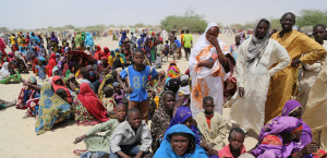 "A handout photo released by the World Food Programme (WFP) shows people evacuated from the Nigerien islands of Lake Chad as they arrive in N'Guigmi on May 5, 2015. Around 25,000 Niger nationals who fled islands in Lake Chad over fears of attack from the Boko Haram jihadist group are living in ""dramatic"" conditions on the mainland, a UN source said on May 6, 2015. AFP PHOTO / WORLD FOOD PROGRAMME -- RESTRICTED TO EDITORIAL USE - MANDATORY CREDIT "" AFP PHOTO / WORLD FOOD PROGRAMME "" - NO MARKETING NO ADVERTISING CAMPAIGNS - DISTRIBUTED AS A SERVICE TO CLIENTS  --"